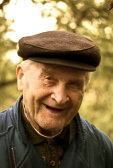 8091579-portrait-of-an-old-man-smiling-to-camera